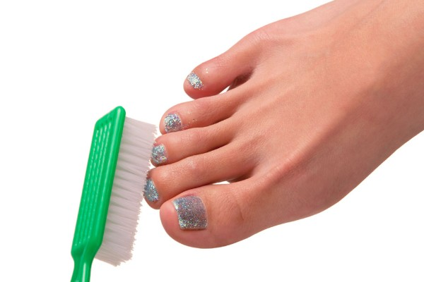 from the gel lamp, brush off the excess glitter with a manicure brush